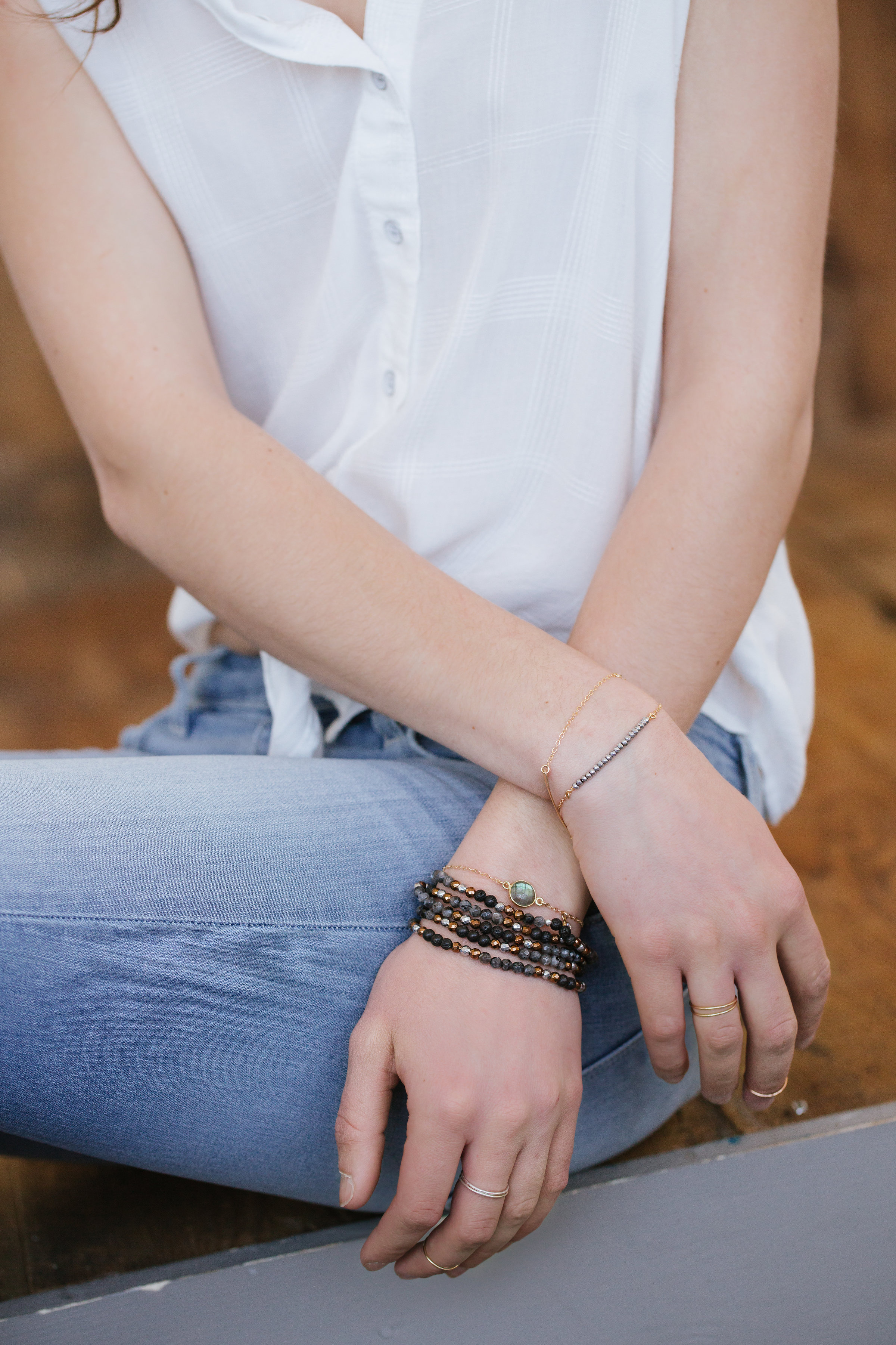 2.Bracelets: - 1. Choose bracelets with various sized beads to achieve dimension.2. Around here, we love to wear bracelets in odd numbers. We typically stick to three bracelets on one wrist - and maybe one more on the other wrist if your feeling spunky!3. For a casual day-time look, I like to stack all beaded bracelets together. And for a dressier, evening look, I like to stack several chain bracelets together and leave my beaded stackers at home.