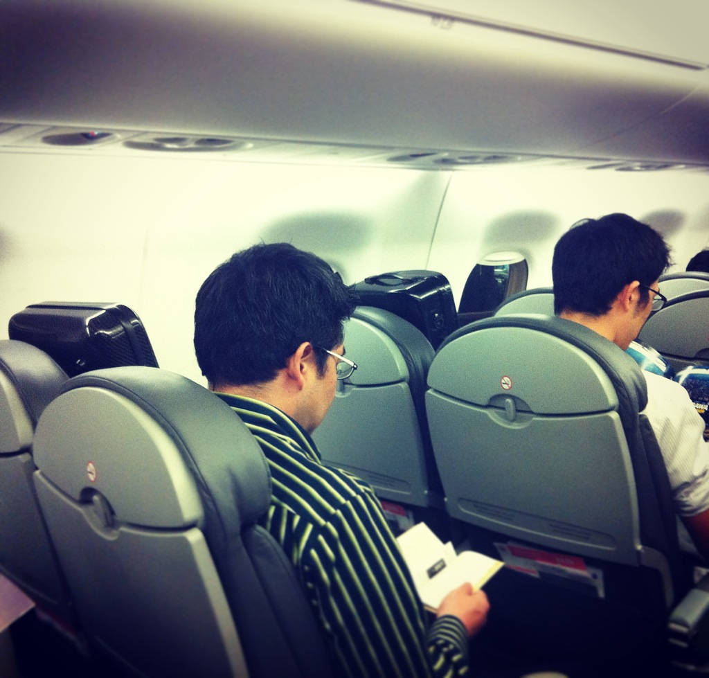 Our violists and their babies strapped into our JAL flight to Osaka!