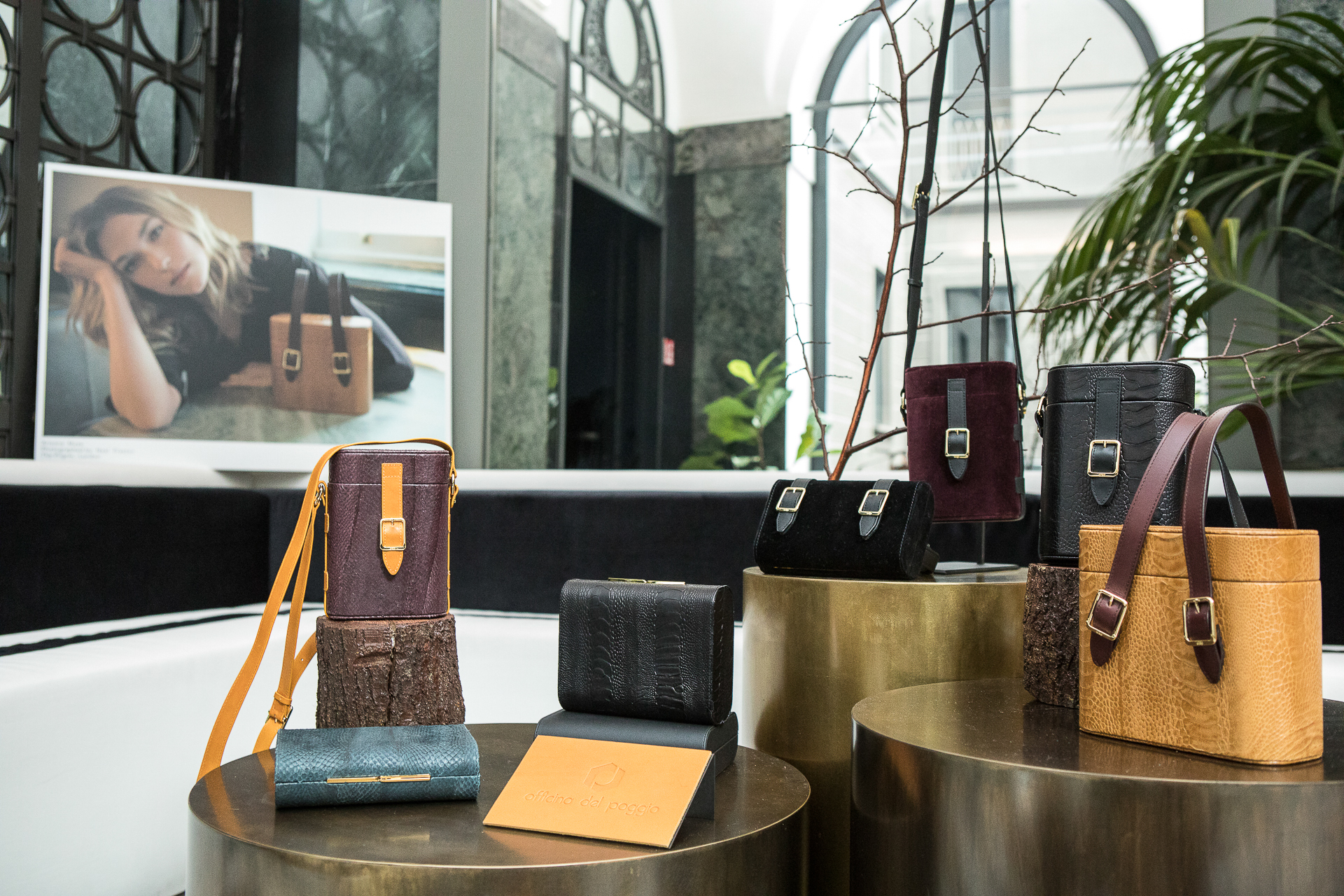 Bags from the capsule collection, featuring sustainable materials such as ostrich leg leather, salmon skin, and organic cotton velvet