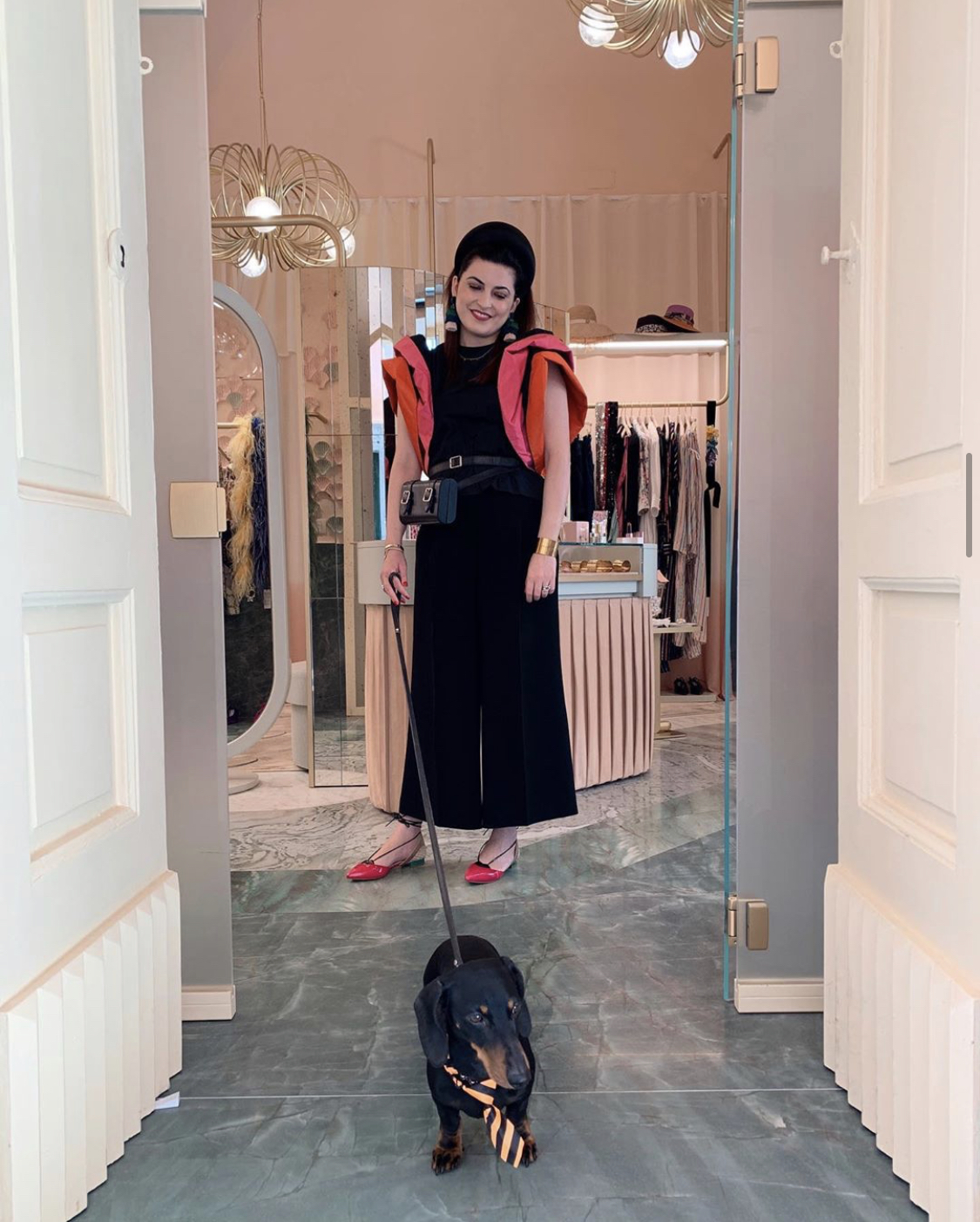 Marilla Avino with the  ODP Bici Bag  at the entrance of The Pink Closet