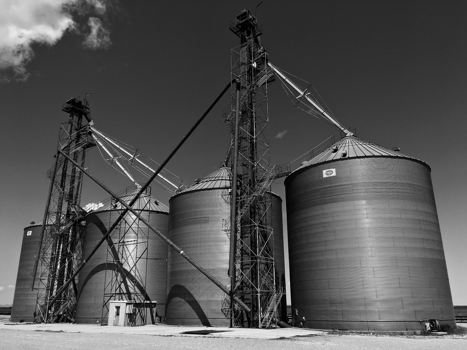 // Some Silos on the Farm Lands of Montana