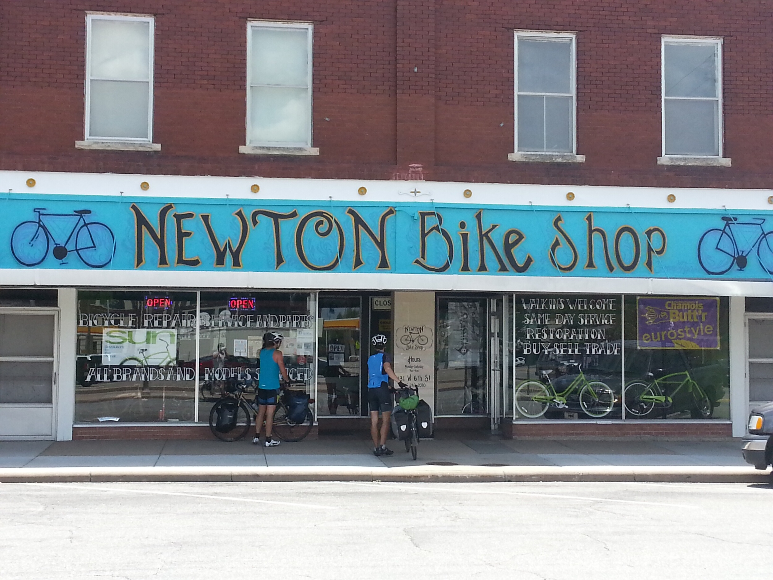 The only bike shop in a billion mile radius. They sold me a Hutchinson UrbanTour tire. Not the same as my front tire, but equally-ish as durable. I think that with better care taken to weight distribution (as I have been taking), I should finish my journey with it intact.