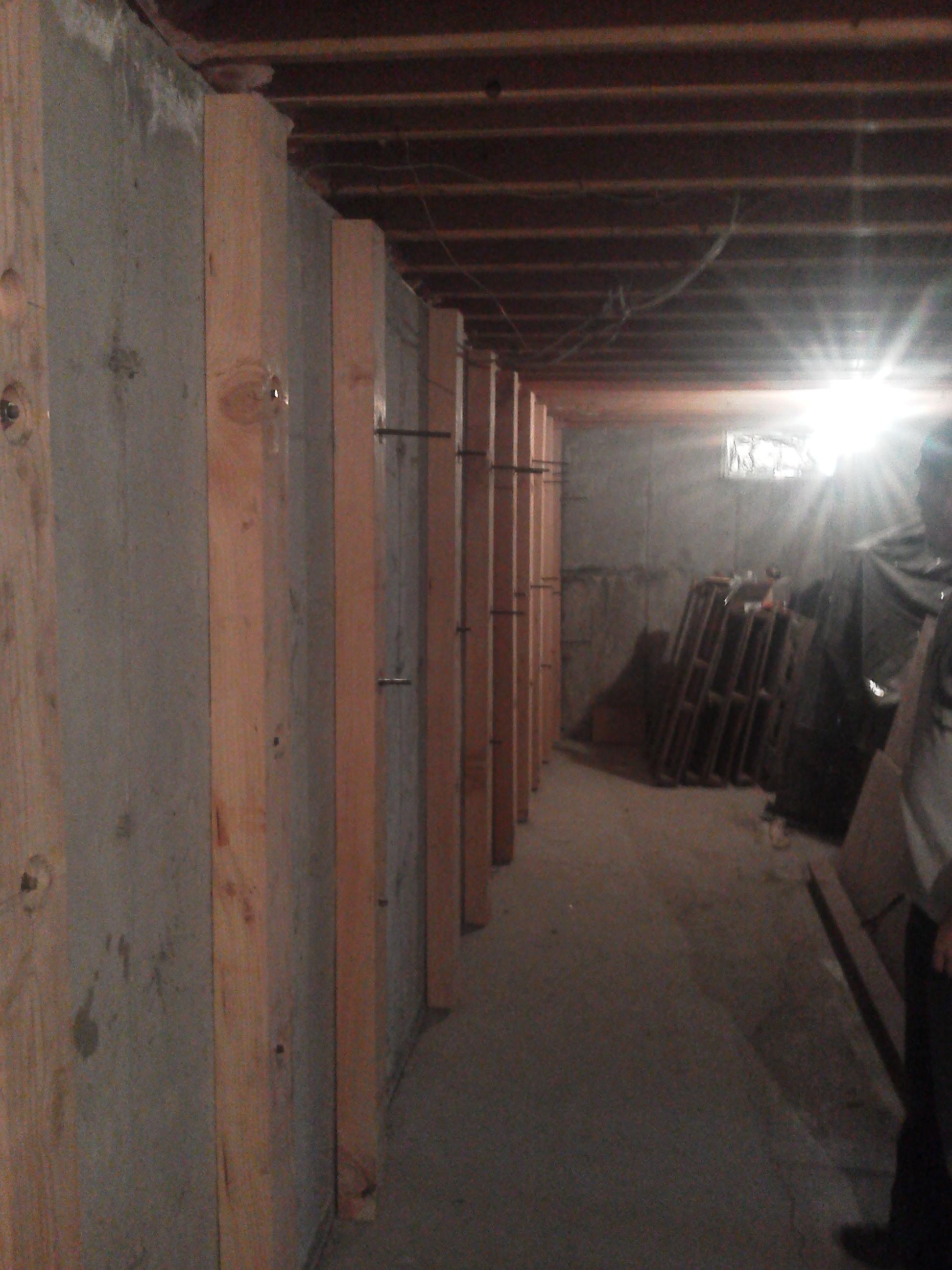 WALL PULLS: Straitening exterior foundation walls