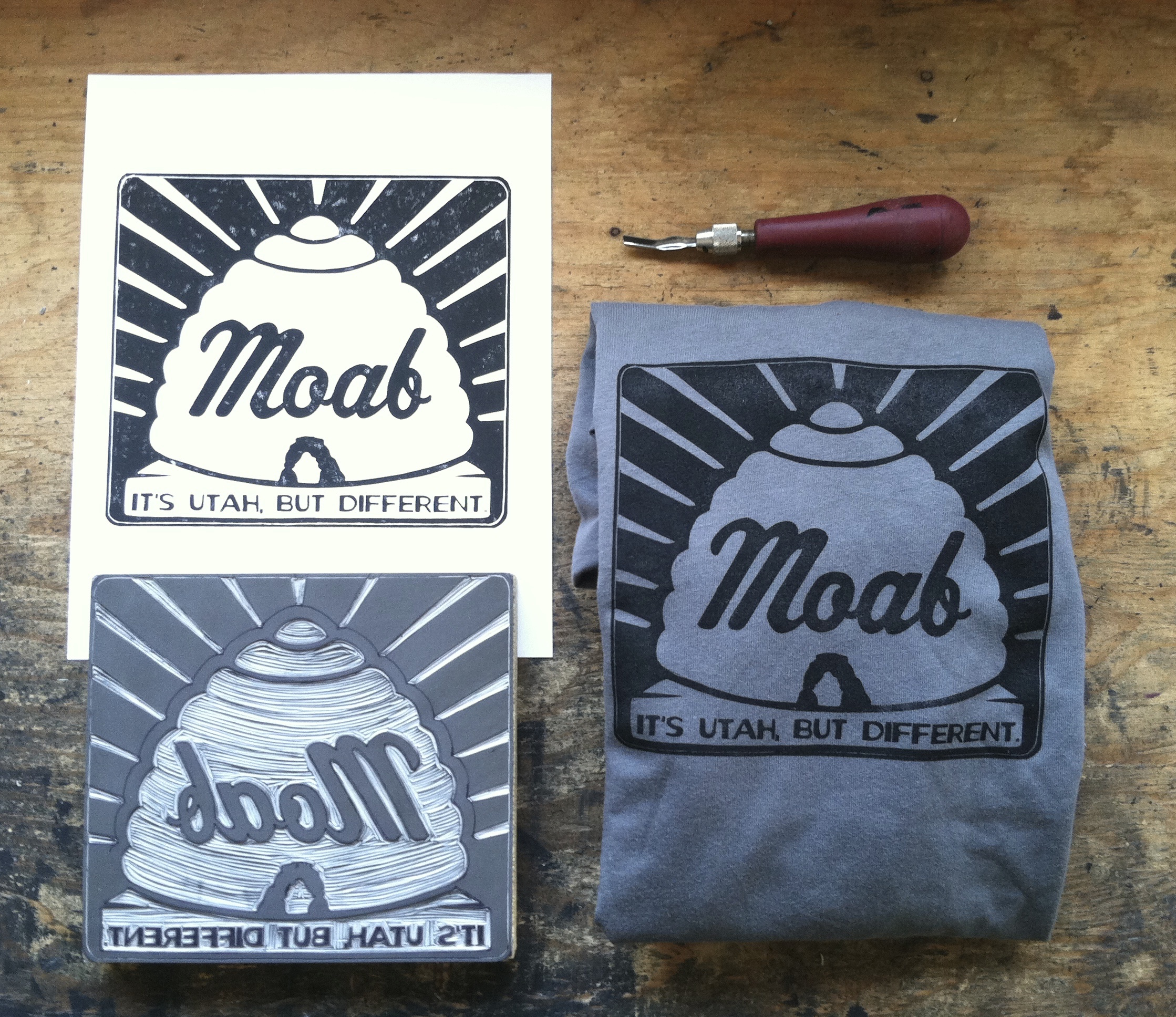 Clockwise from top left: a print on paper; my trusty carving tool; a footprinted T-shirt; the hand-carved linoleum block used for creating all of this stuff.