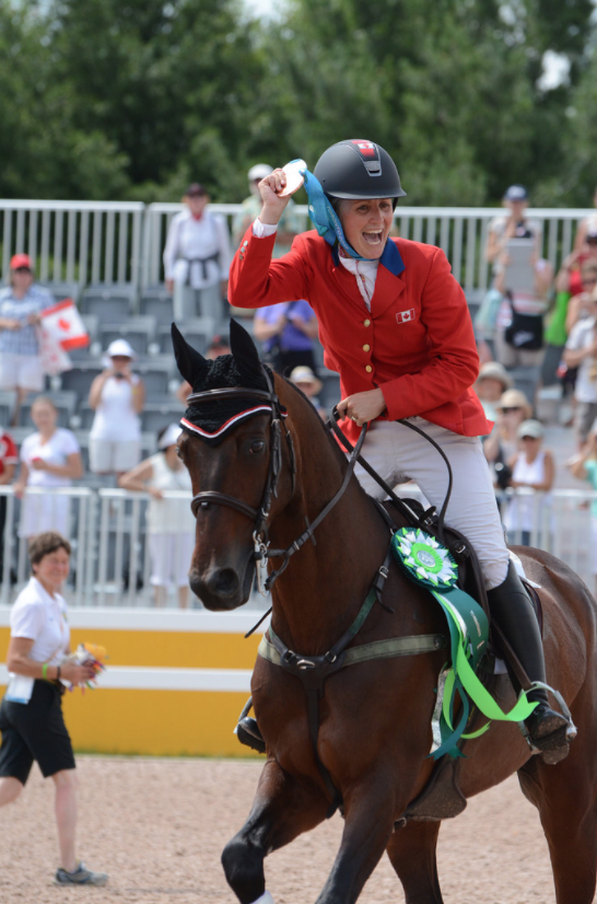 "Jessica Phoenix and ""Pavarotti"" at the 2015 PAN AM Games in Toronto. Jessica uses ReitenRight Premium Footing."