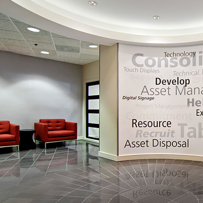 Custom graphics were designed to highlight the business services in the reception area.