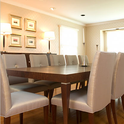 A formal dining room designed to accommodate twelve, which also needed to be family-friendly. Heavy duty upholstery that could be easily cleaned, but still look elegant, in a metallic finish and button detail complimented a custom-made table and console with silver-leaf detail.