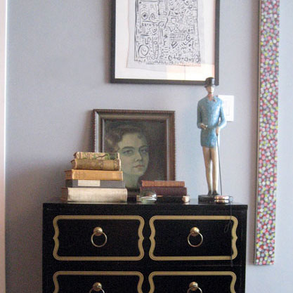 Create small vignettes with a mix of antique and modern items.