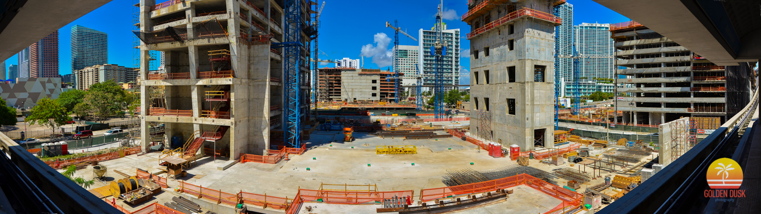 April 2014  - The underground parking has completed its rise and concrete has been poured to make way for the construction of the steel beams. Tobacco Road can no longer be seen. The Wellness Center, Condo North and Condo West have started to rise and their parking garages have been completed.