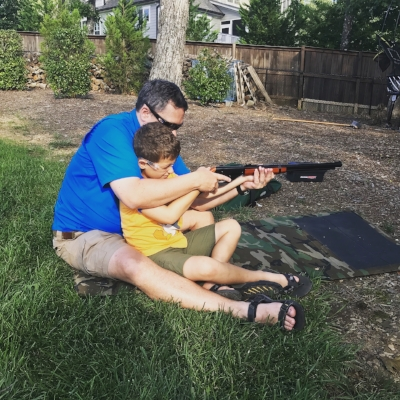 My sons first shot with his Red Ryder.
