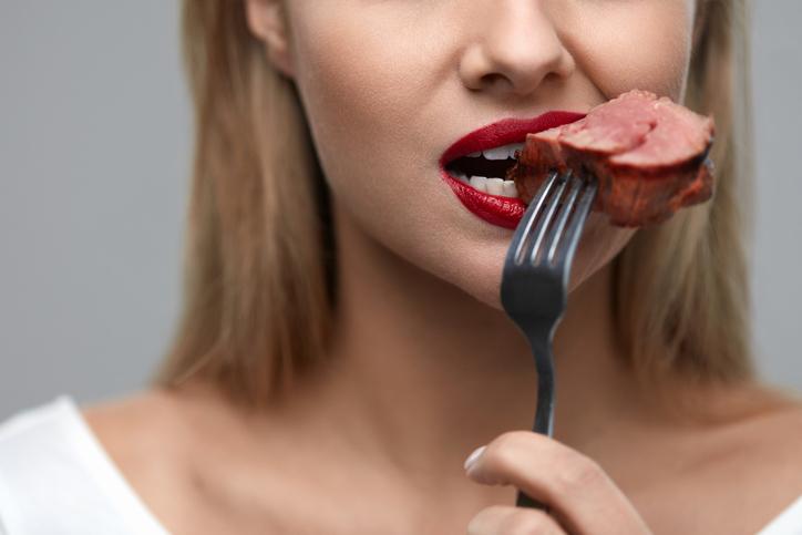 Person Eating Steak.jpg