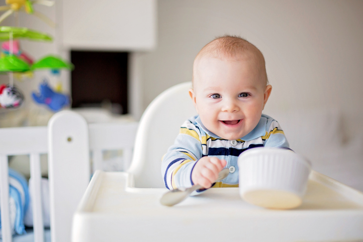 Baby With Spoon And Dish.jpg