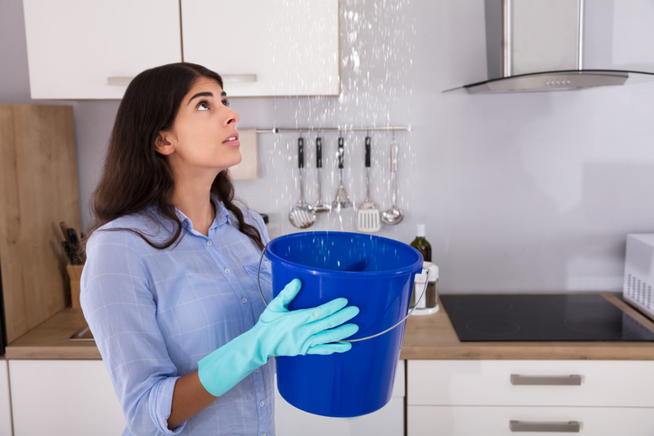 Catching water from leaky roof.jpg