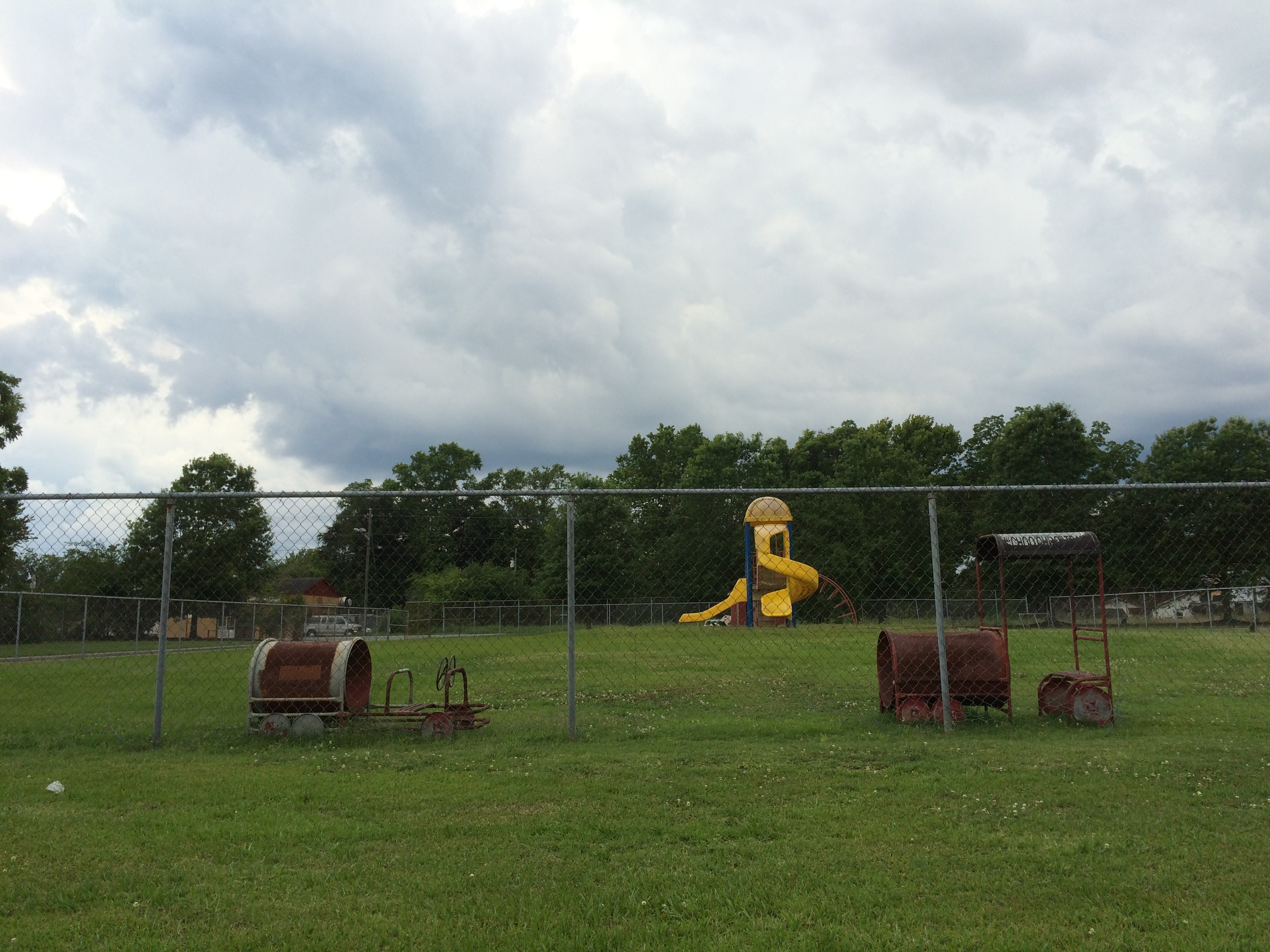 This is the playground of an elementary school on the east side of Savannah. It's only features are two rusted train cabooses and a large plastic slide.