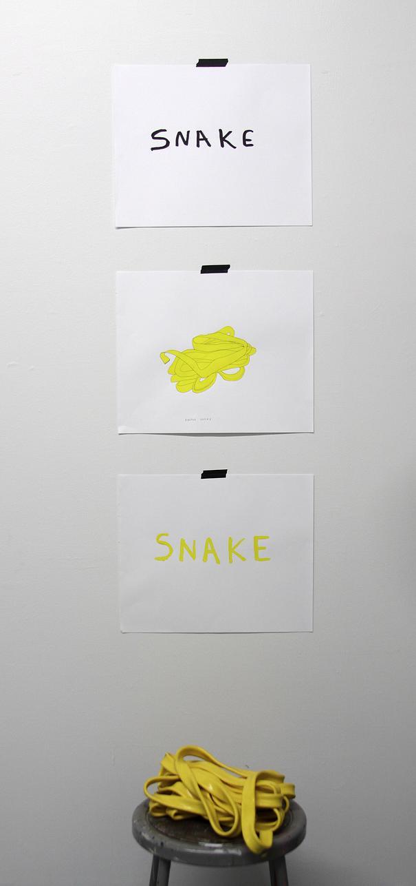 Banana Snake , ink on paper, black masking tape, yellow rubber tube, stool, 2015