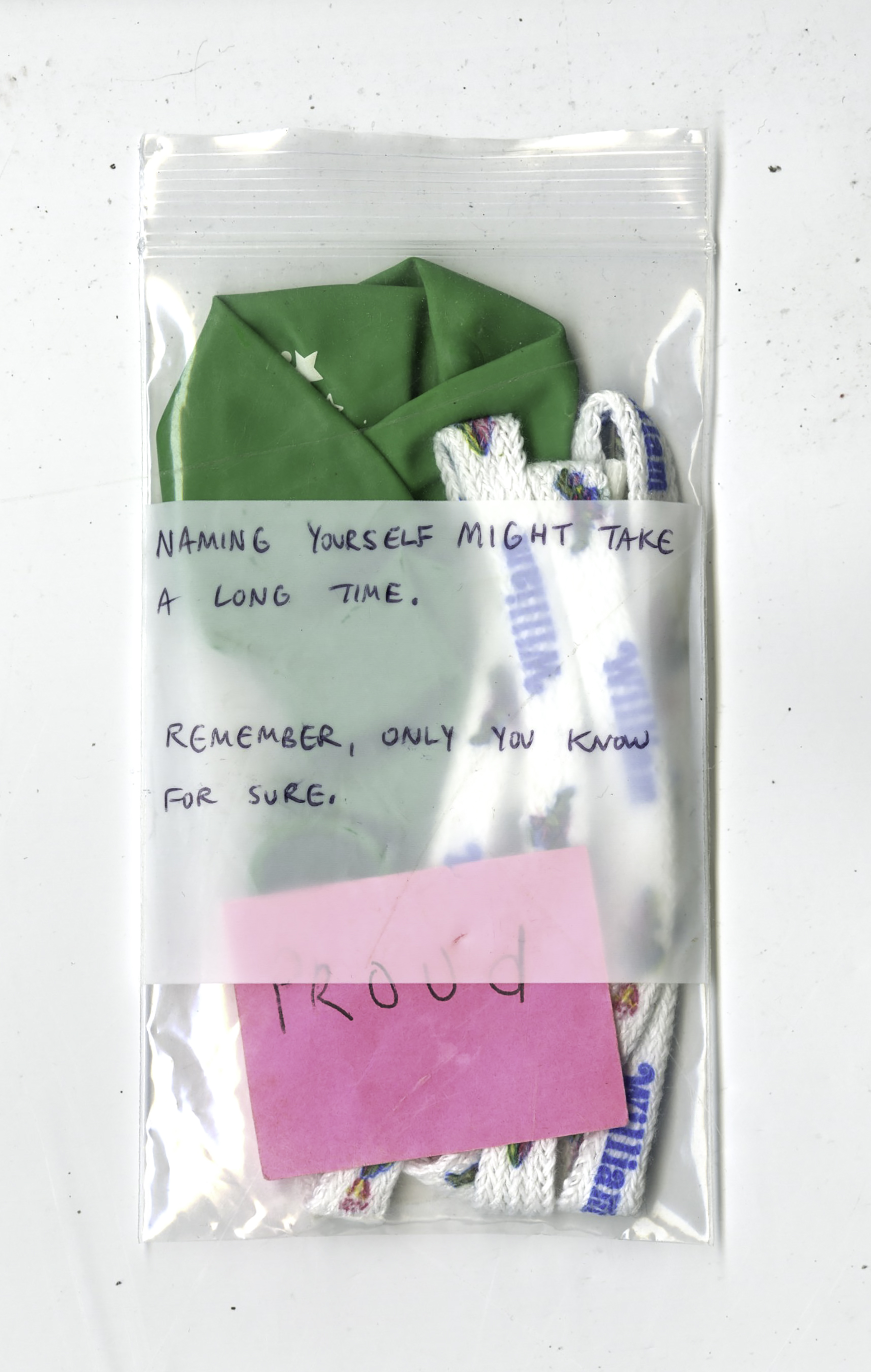 "Naming yourself might take a long time. Remember, only you know for sure. , Noah balloon, William shoelaces, ""proud"" sticky note, Luan Bahn Mi receipt from Red Emma's cafe, bag, 2016"