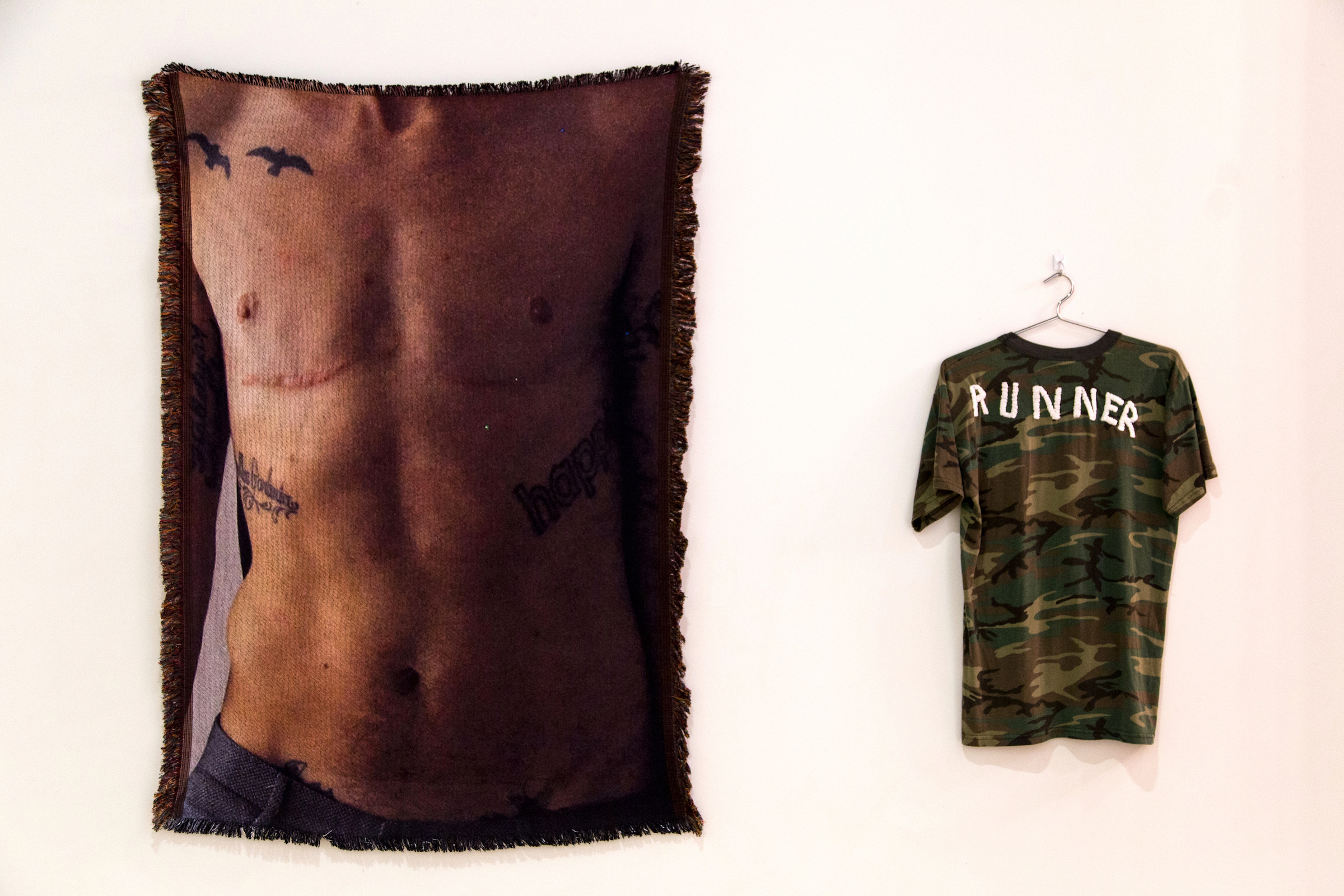 "Sawyer  with  Runner , 2017, photo-sublimated woven blanket, 54"" x 38"", embroidered tee, 24"" x 16"""