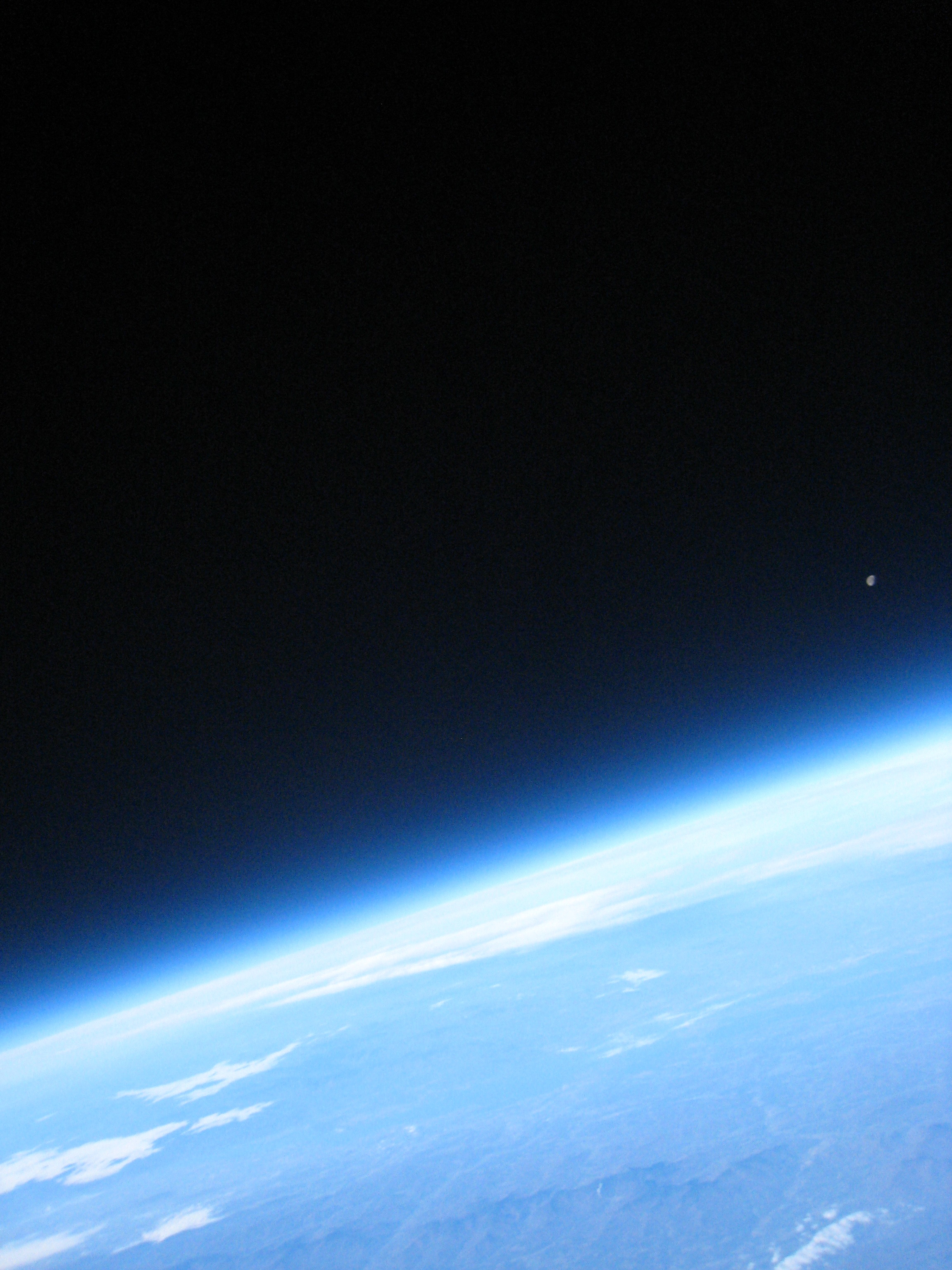 "Picture from an altitude near 98,000 feet.  Looking west at the setting moon.  Vermont's Green Mountains are visible.  Profile's payload box made it to ""near space"" and we had the pictures to show for it!"