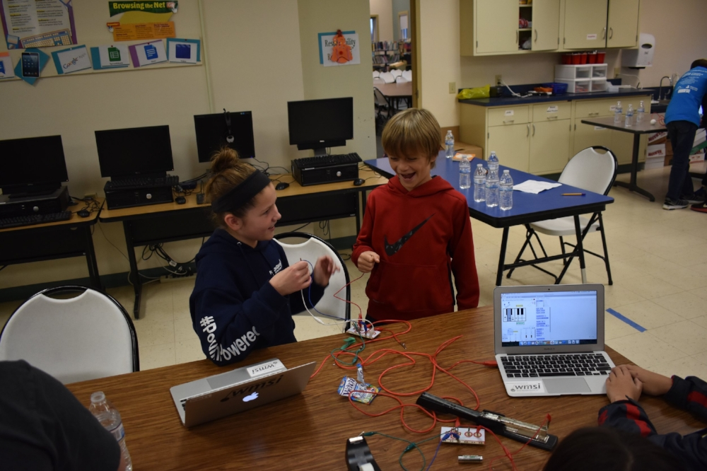 Milan students wiring up game controllers for their new creation!
