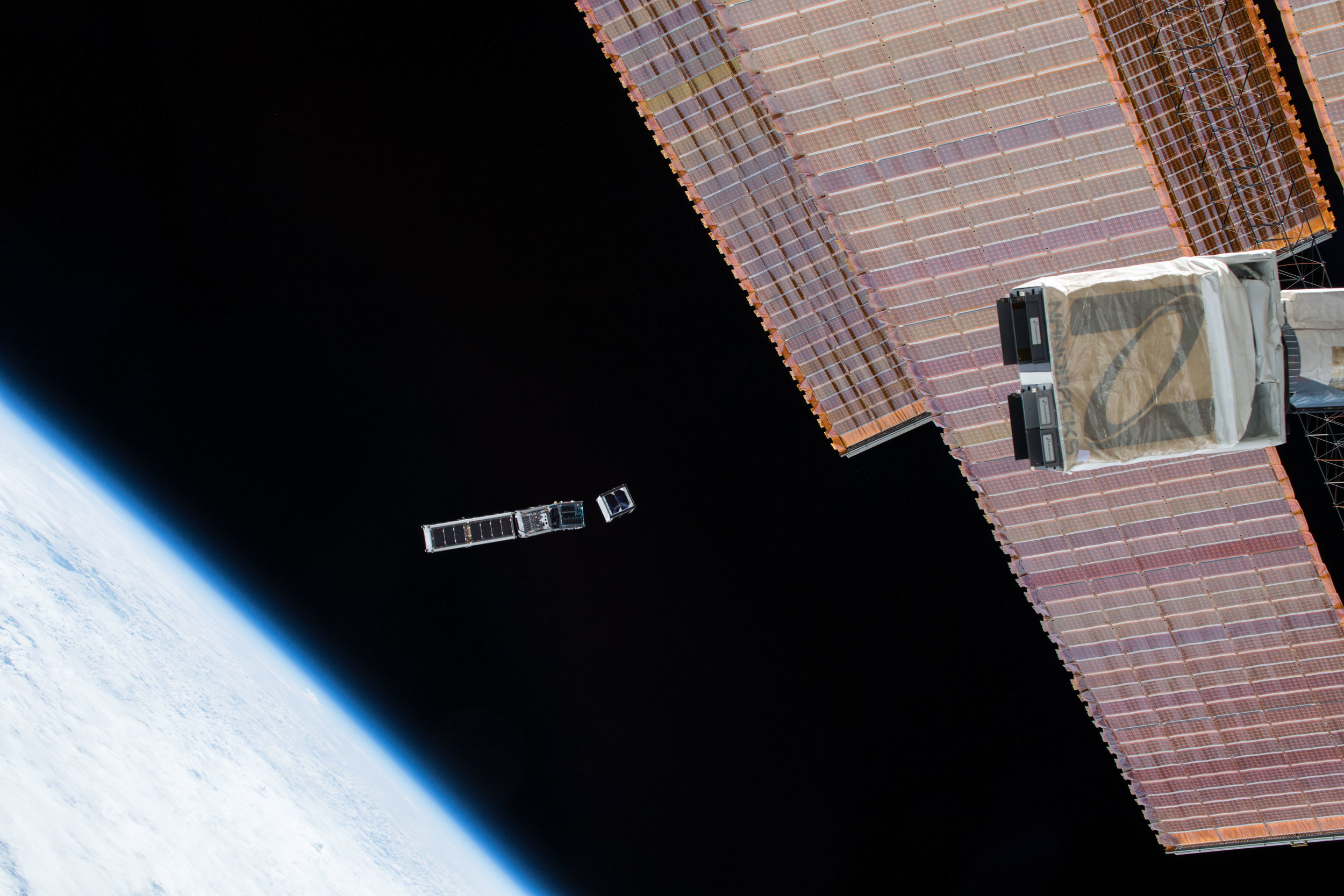 EQUiSat deploying from the ISS. It is the second CubeSat from the right