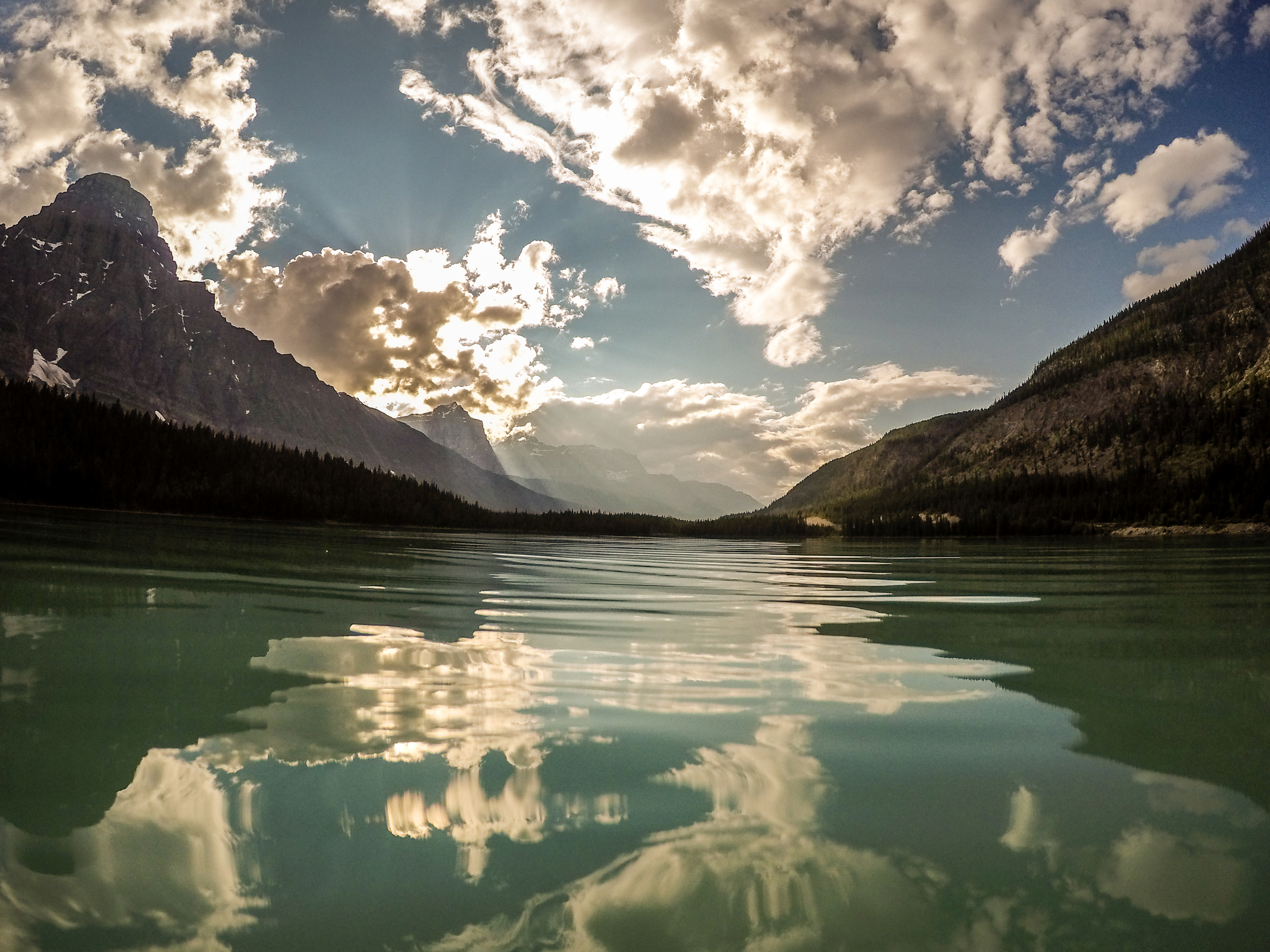 A beautiful reflection of the cloudy sky on Waterfowl Lake.