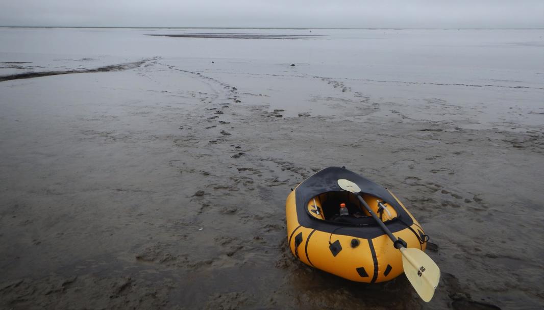 Leaving the Meshik River through the tidal mud to start the last 11 mile leg backpacking overland.