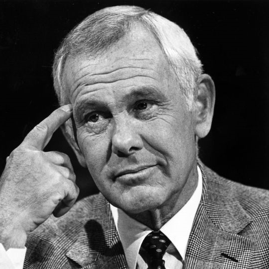 """Happiness is having a rare steak, a bottle of whisky, and a dog to eat the rare steak "" - Johnny Carson, Late Night Host"