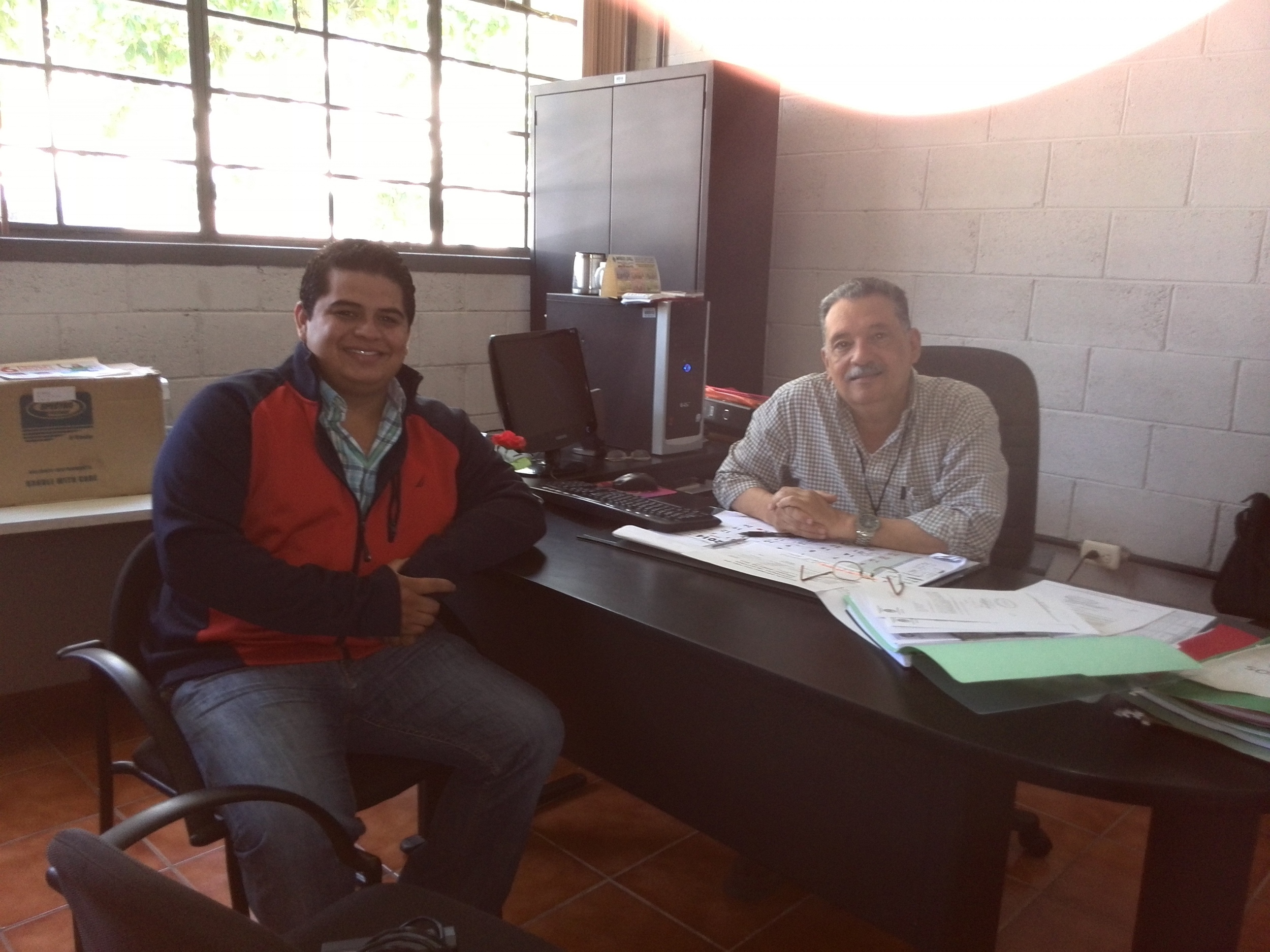 Rogelio meeting with Engineer Silvio Rodriguez, Professional Internship Director and Supervisor at San Carlos University, to discuss the conflict surveys he will be conducting in Santa Otilia as part of his internship program.