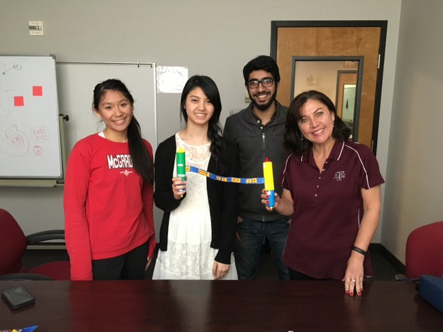 "Team ""Veggie Roll"" and their CDF Mentor showing the seed spacing device they designed for kids."