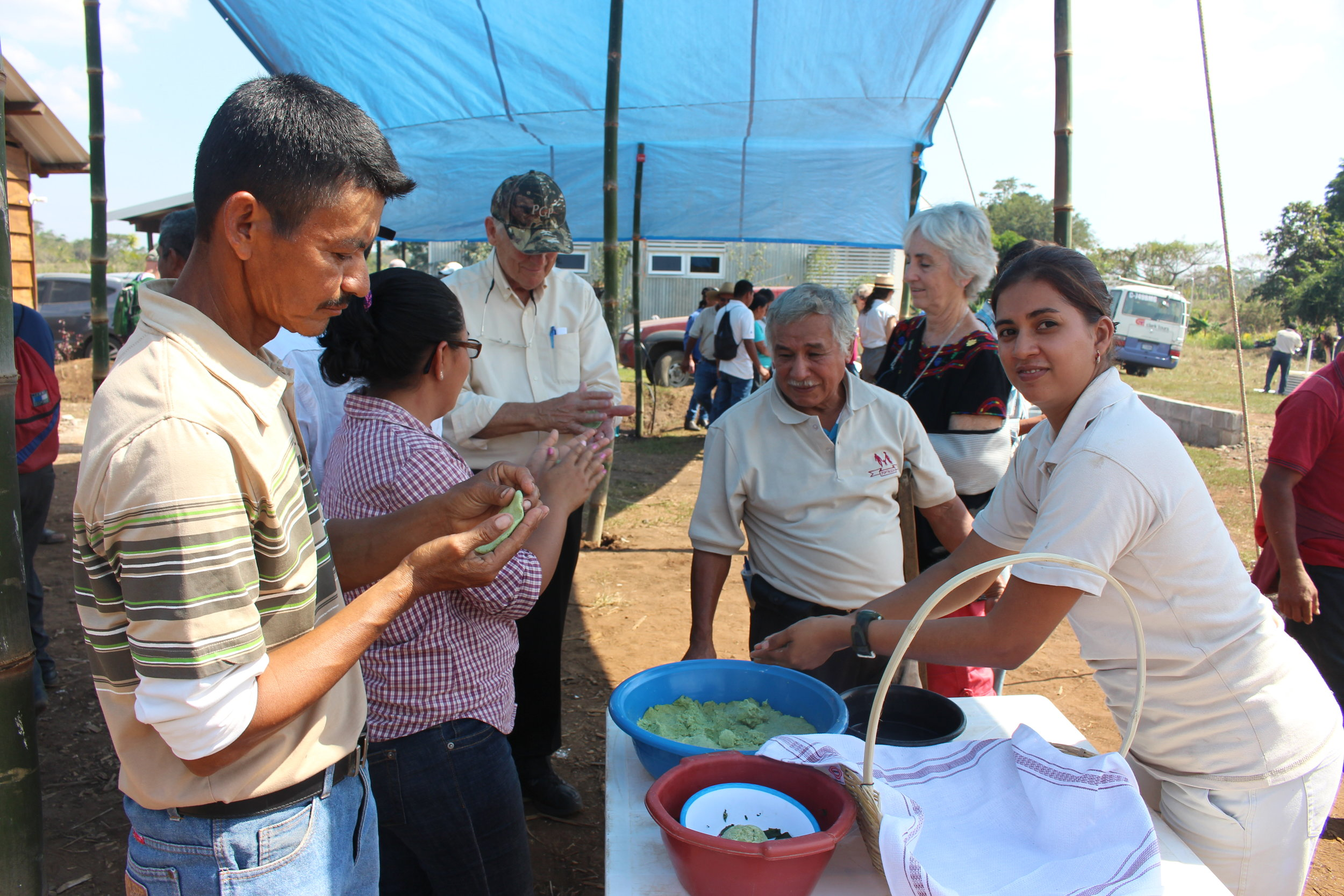 Farmers preparing tortillas using Quality Protein Maize