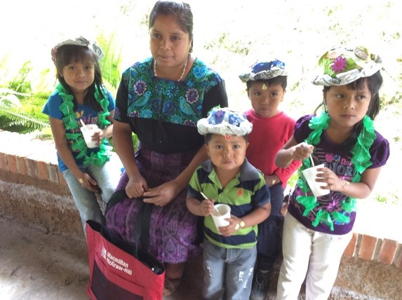 A Mayan family in a coffee-growing community in Guatemala participating in our Junior Master Gardener activities.