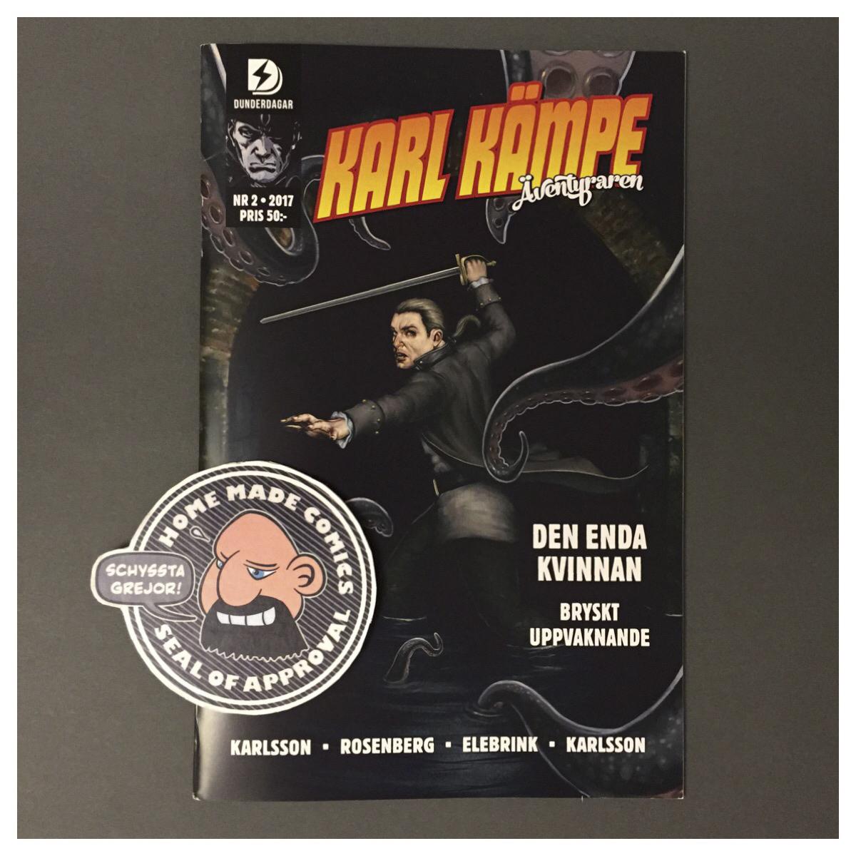 Home Made Comics Seal of Approval #203. Karl Kämpe Äventyraren 2 av Jörgen Karlsson, Reine Rosenberg, Johan Elebrink och Daniel Karlsson utgiven av Dunderdagar 2017.