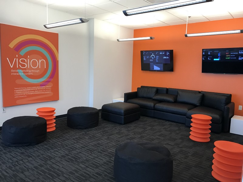 ion interactive's new headquarters includes this living room with their vision, values and metrics dashboard live streamed.