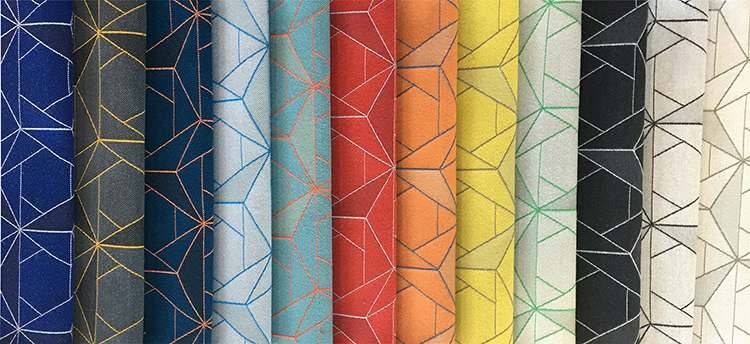 Folded Lines  is a geometric floral pattern made up of layered triangles with fine outlines. By altering the weave structure, the design achieves subtle color changes that create a second layer to the pattern. Folded Line is suitable for both upholstery and wrapped panel applications, with a 100% recycled content construction that is also bleach cleanable. Available in 12 colorways.