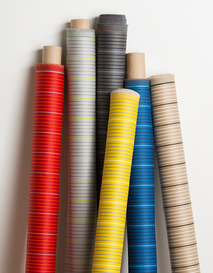 Changing Lines  is an elegant wool fabric. The two colors stripes gives an illusion of larger stripes in a subtle way. The shine of this material makes it even more luxurious. Available in 6 colorways.