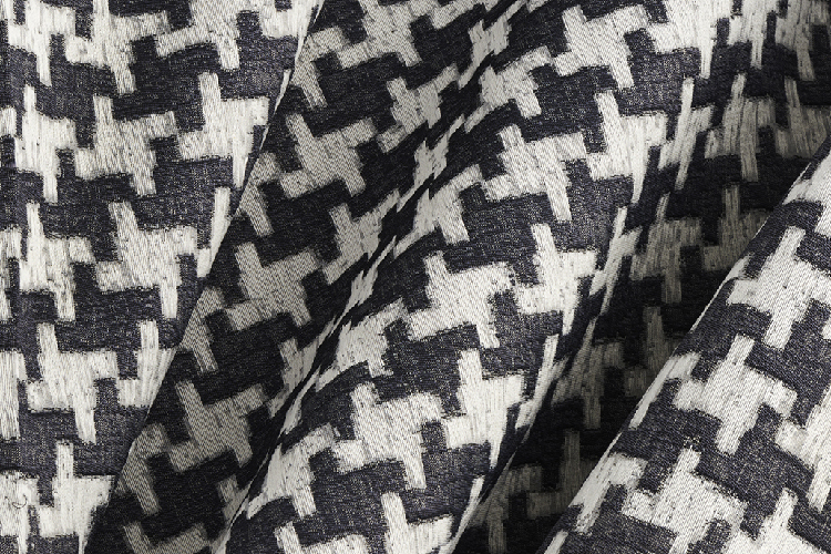 Remember Houndstooth  - A pull-out design from Elodie's Remember fabric, is enlarged 200 percent to create an all-over, large-scale, classic black-and-white houndstooth. It can stand alone or work in coordination with Remember. Available in black & white.