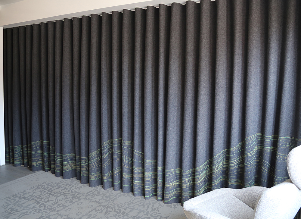 Linear Landscape  curtain in dark grey with yellow and chartreuse green stitching.
