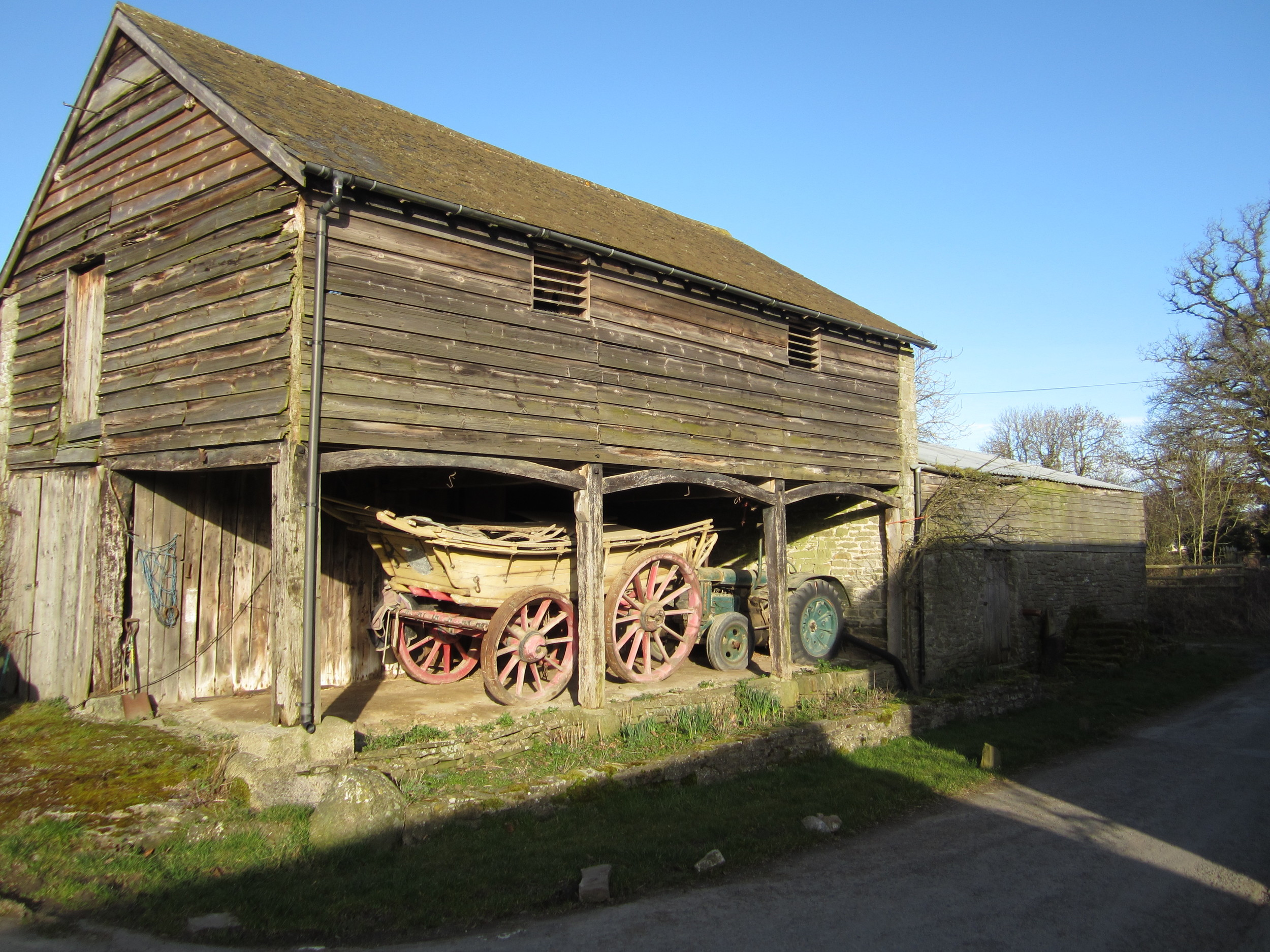 Retired farm machinery at Lower House Farm provides a permanent, central landmark in the village