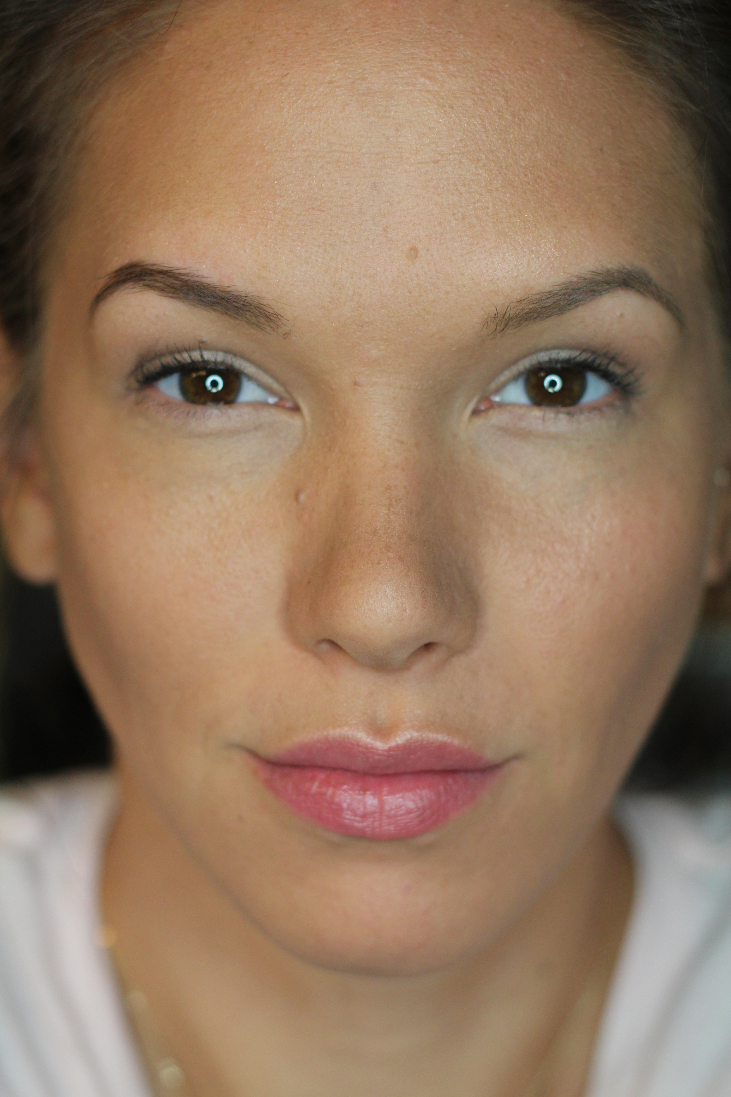 Powder Contour Application applied to the hollows of the cheeks, bridge of the nose, hairline and jaw line.