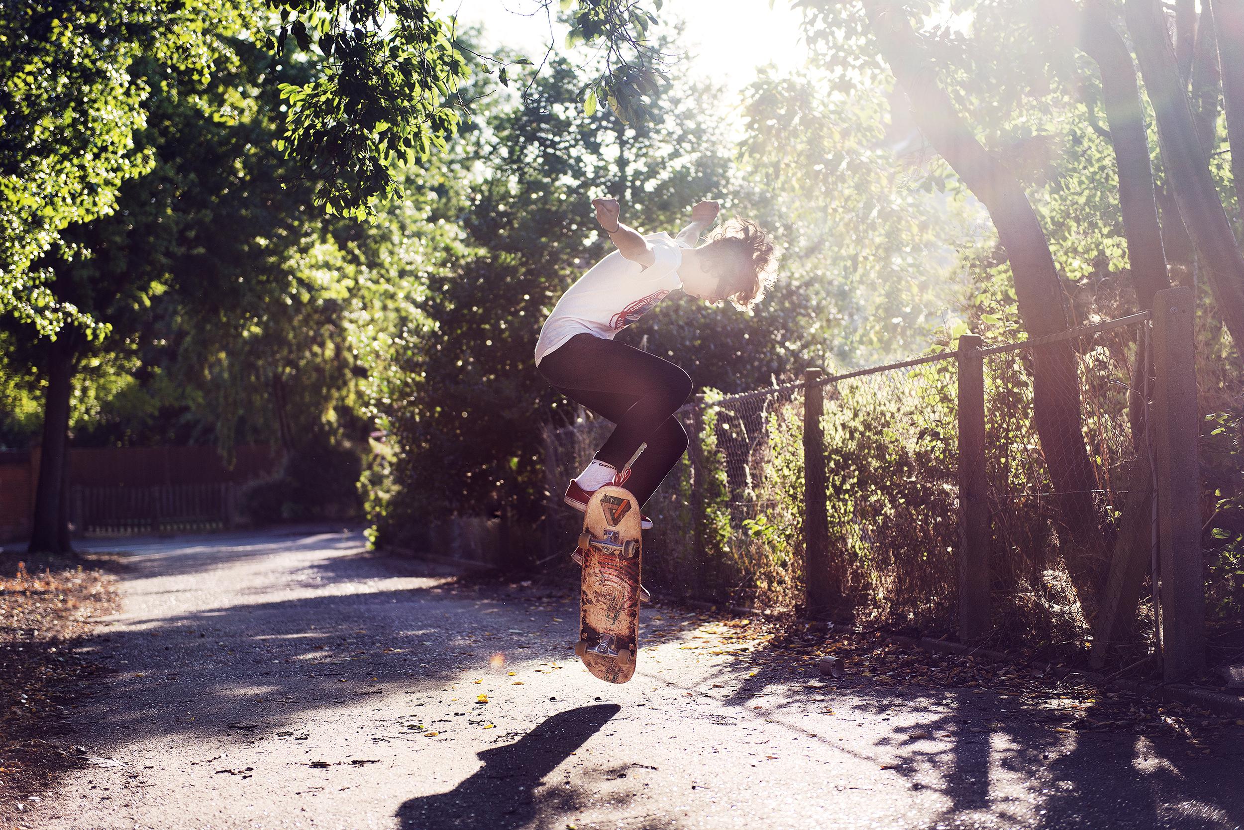 boy skateboarding kid with sun flare copy.jpg