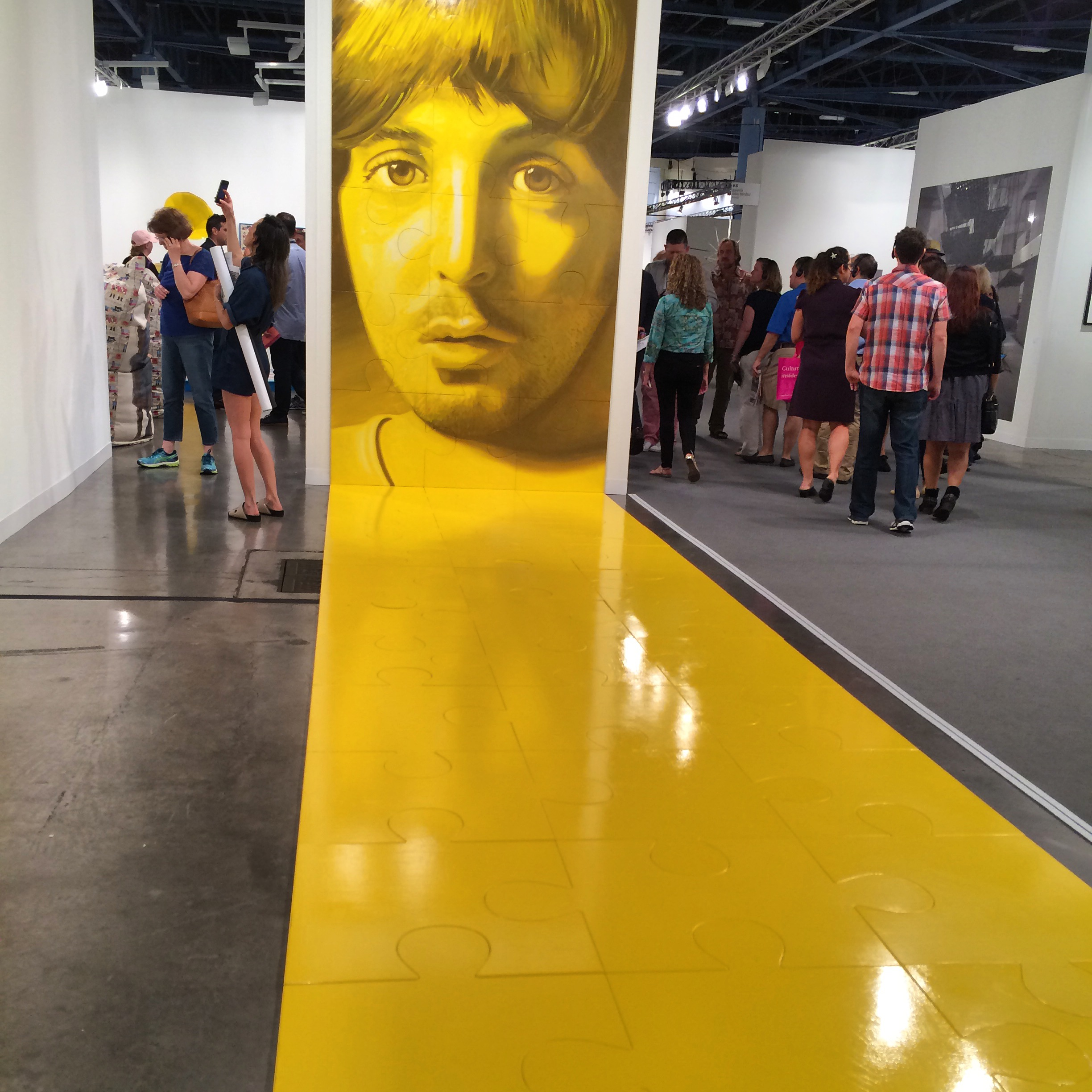 Jack Early's solo presentation at Fergus   McCaffrey (New York and St. Barth's) had us with the giant blown-up portraits of Paul McCartney and John Lennon, facing each other across a floor of bright yellow puzzle pieces. Yes, it was fun, intelligent, and had us all taking snaps.