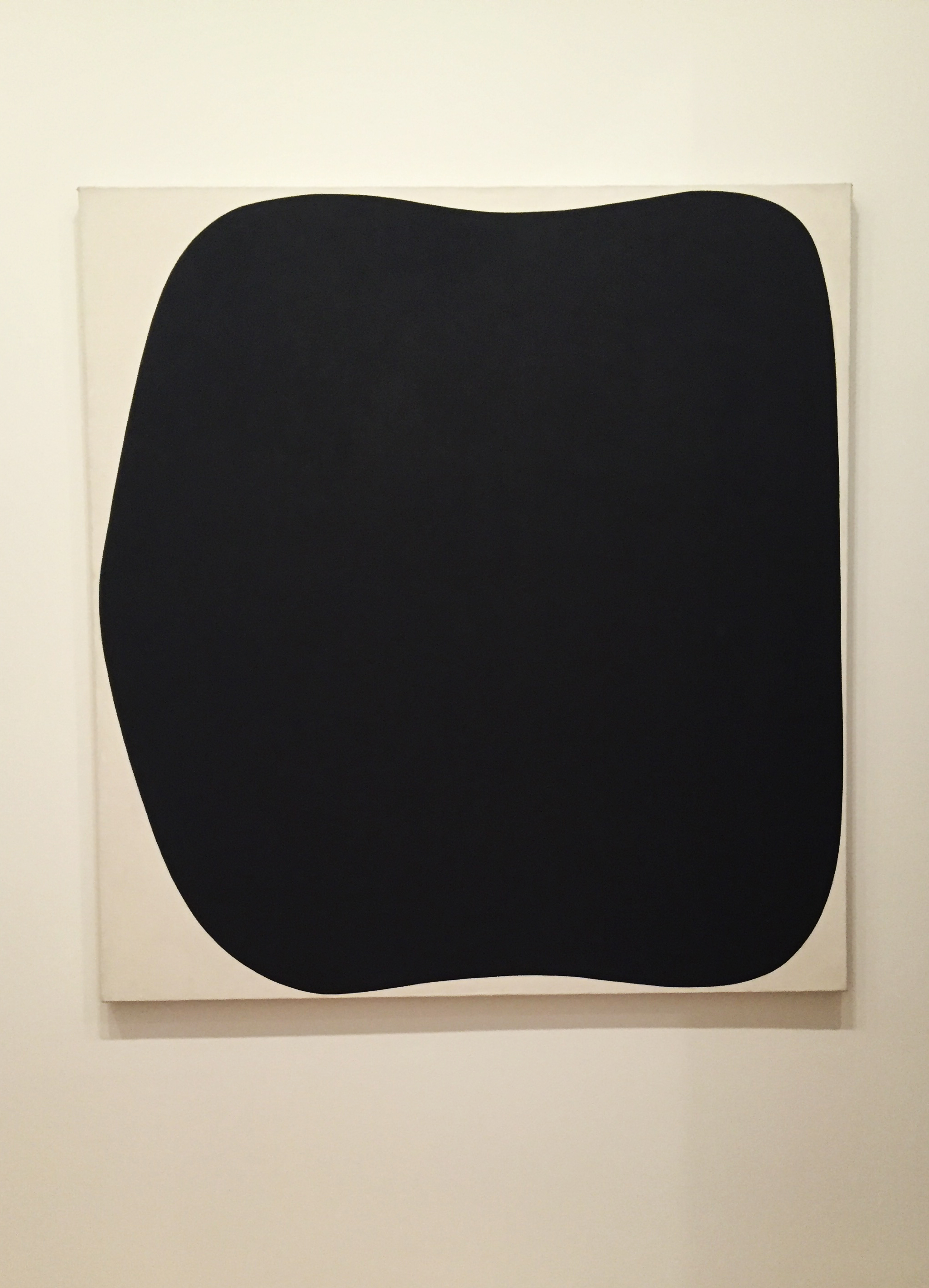 """Ellsworth Kelly (American, 1923) wanted us to see form and relationships when looking at his work. He named this work, """"Black Ripe"""" (1955, oil on canvas), after visiting the studio of his buddy, Alexander Calder."""