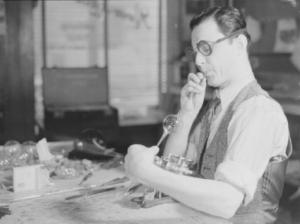 Glassblower Romeo Lefebvre in his workshop in Montreal, 1942.