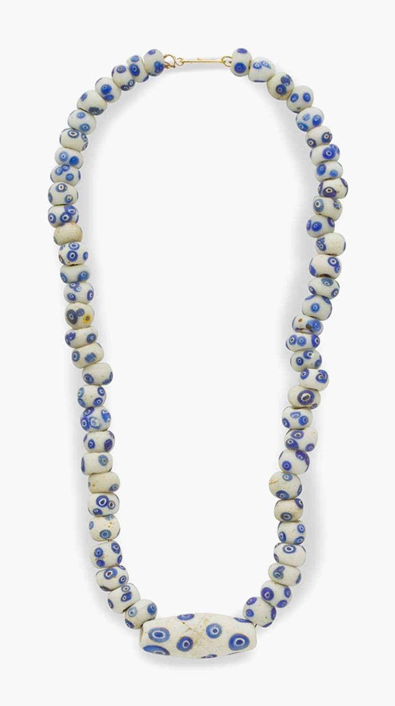 A Carthaginian white and blue glass eye-bead necklace . Circa 4th-2nd century B.C. 18¾ in (47 cm) long. Estimate: $5,000-7,000. This lot is offered in  Ancient Jewelry: Wearable Art , 29 November–8 December 2016, Online