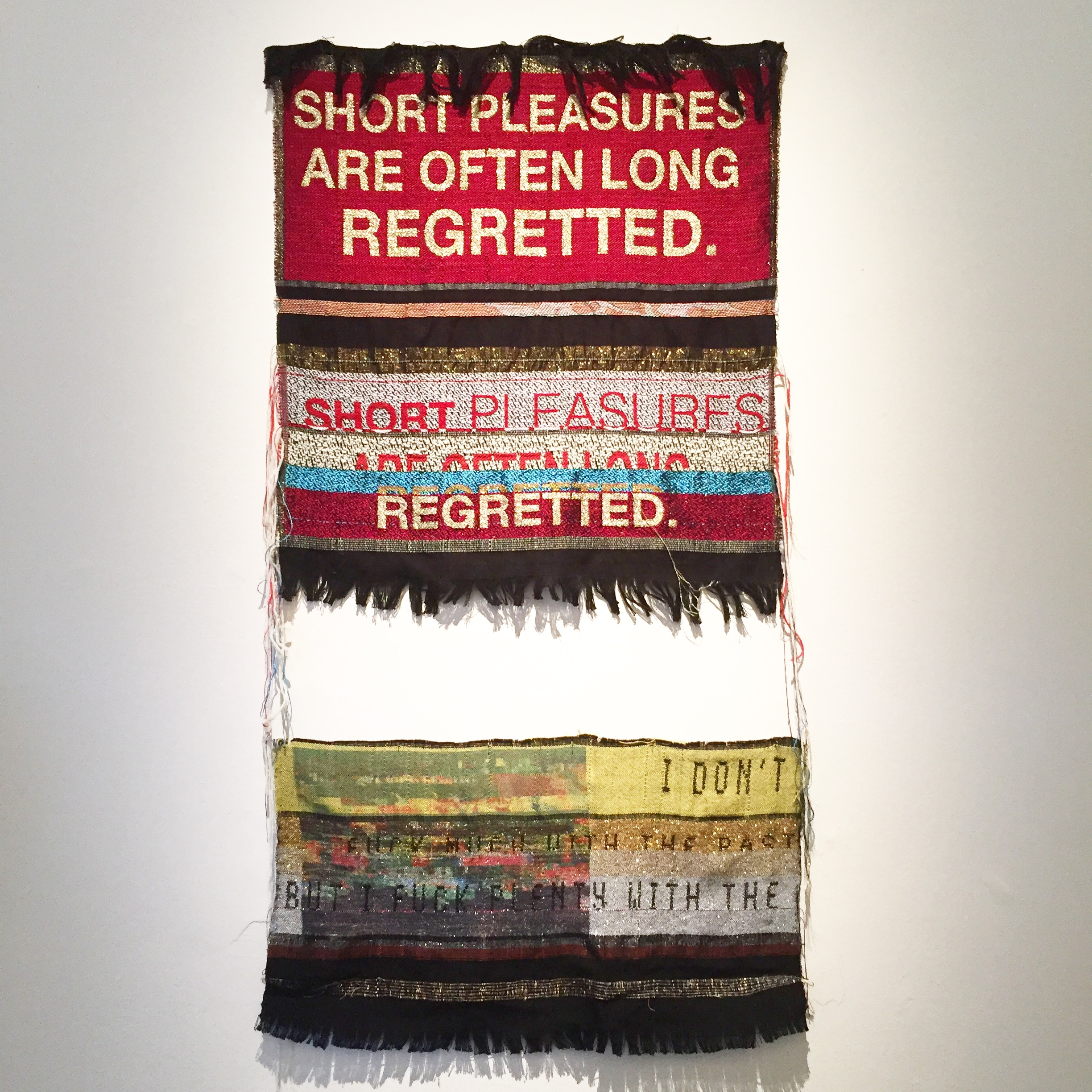 Danielle Andres's.  Short Pleasures, 2016 , and  I Don't Fuck Much With the Past, 2016 .Jacquard woven fabric, text.