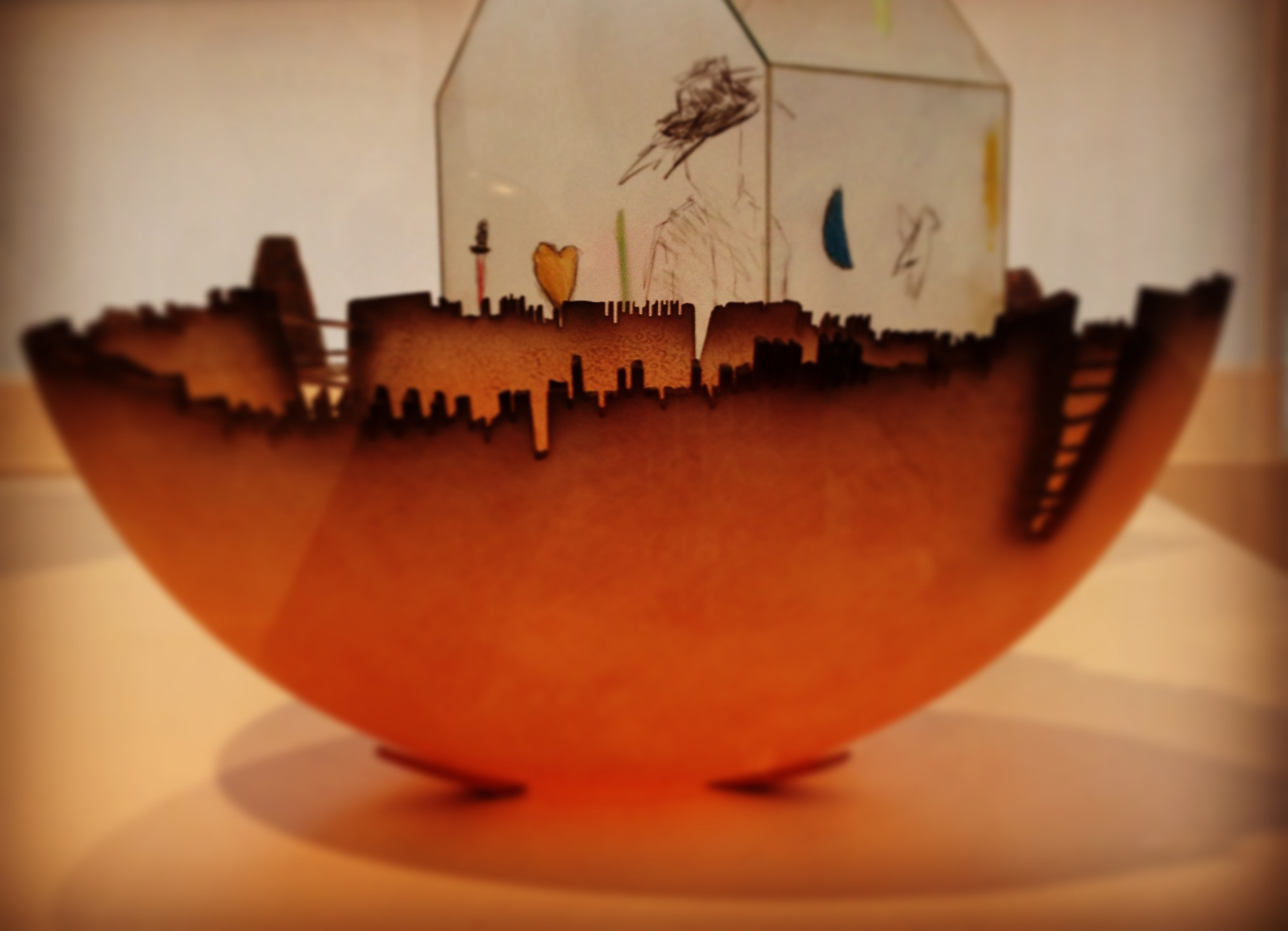 """""""Cityscape"""" by Jay Musler (American, 1949), from the  Urban Bowl Series , 1982,  carved and blown glass , collection Los Angeles County Museum of Art, photo by Micaëla van Zwoll."""