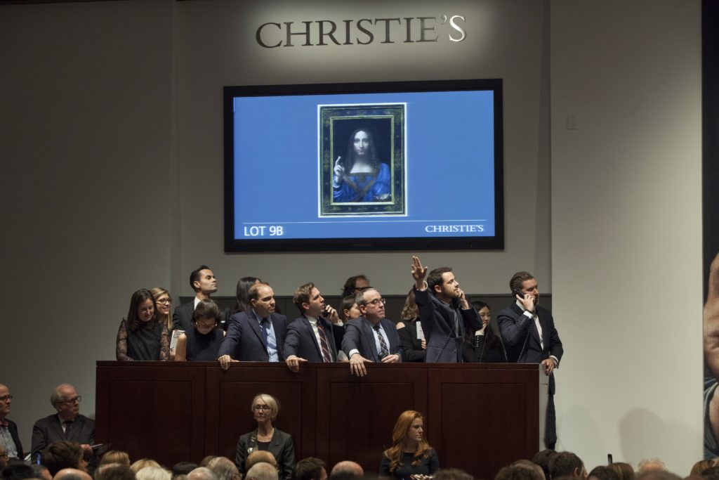 Loic Gouzer bidding on Leonardo's  Salvator Mundi  from the phone bank. Photo courtesy of Christie's.