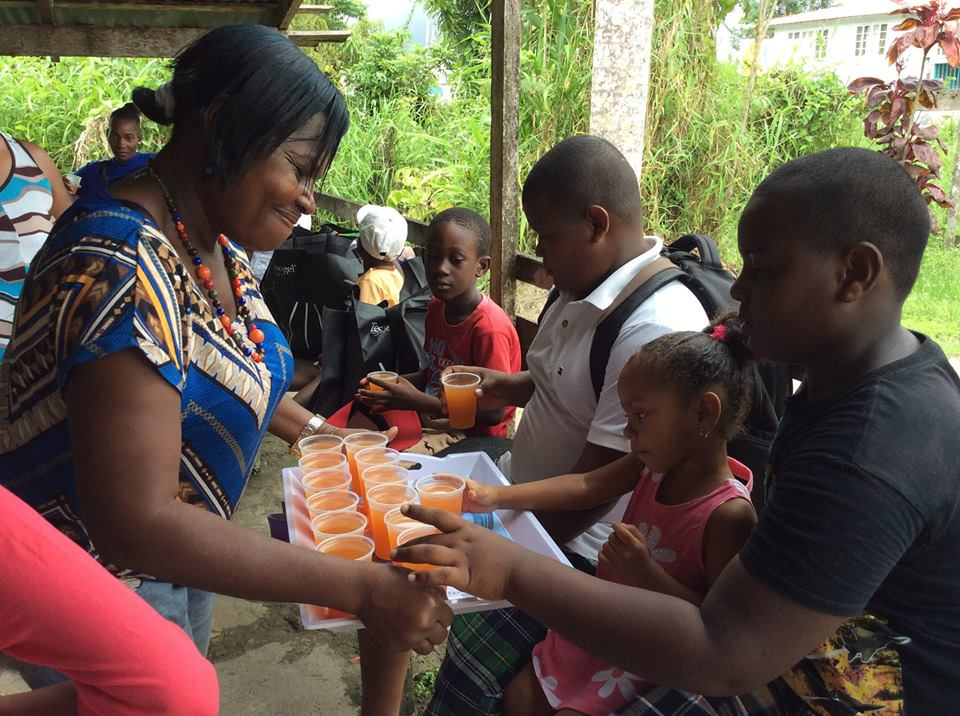 Refreshments being shared to children at a recent Guyana Foundation activity in Soesdyke, East Bank Demerara.