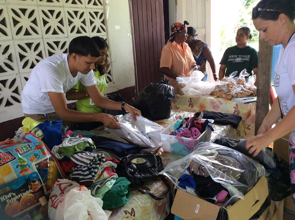 Volunteers setting up tables of donations to hand-over.