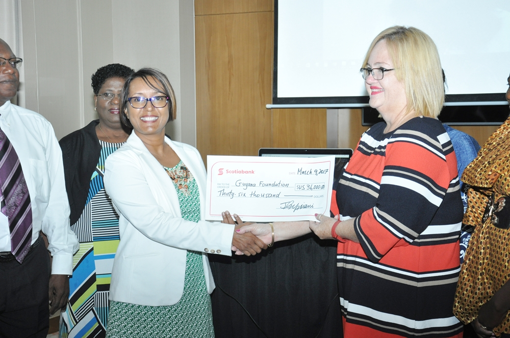 The cheque of $US36,000 being presented to Ms. Susan Isaacs, Managing Director of the Guyana Foundation by Ms. Jennifer Cipriani of Scotia Bank (left).